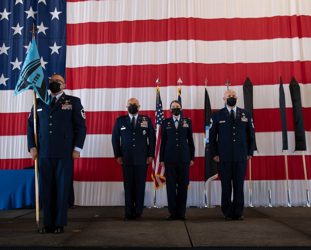 Service members stand at attention during ceremony