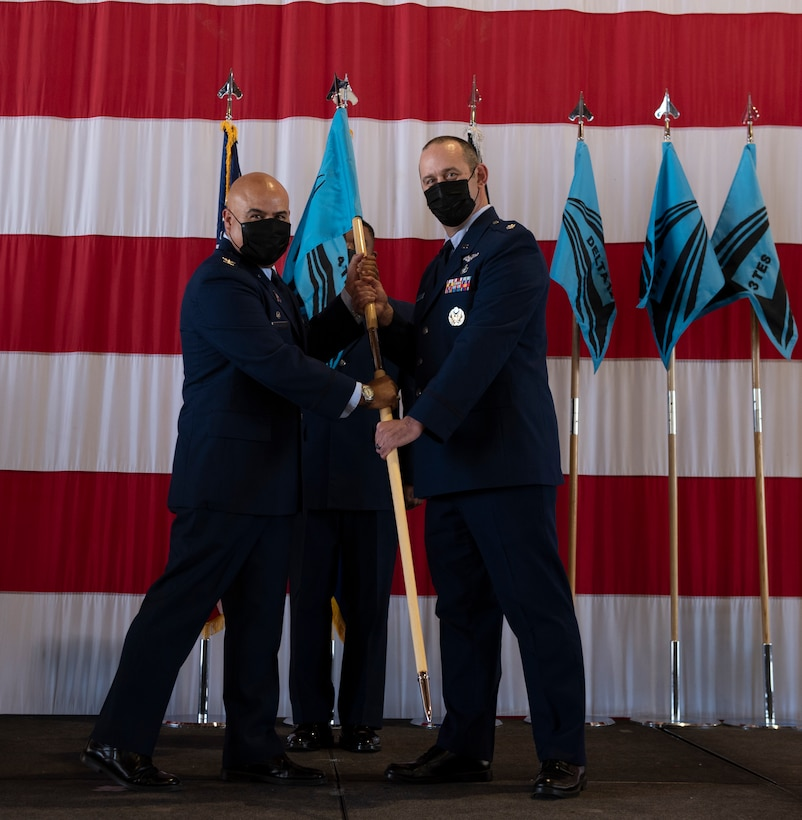 Commander hands off guidon during assumption of command ceremony