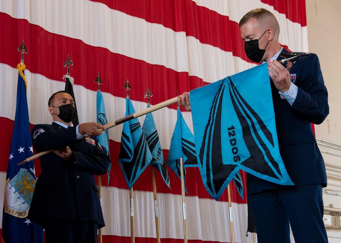 Commander unfurling new squadron flag