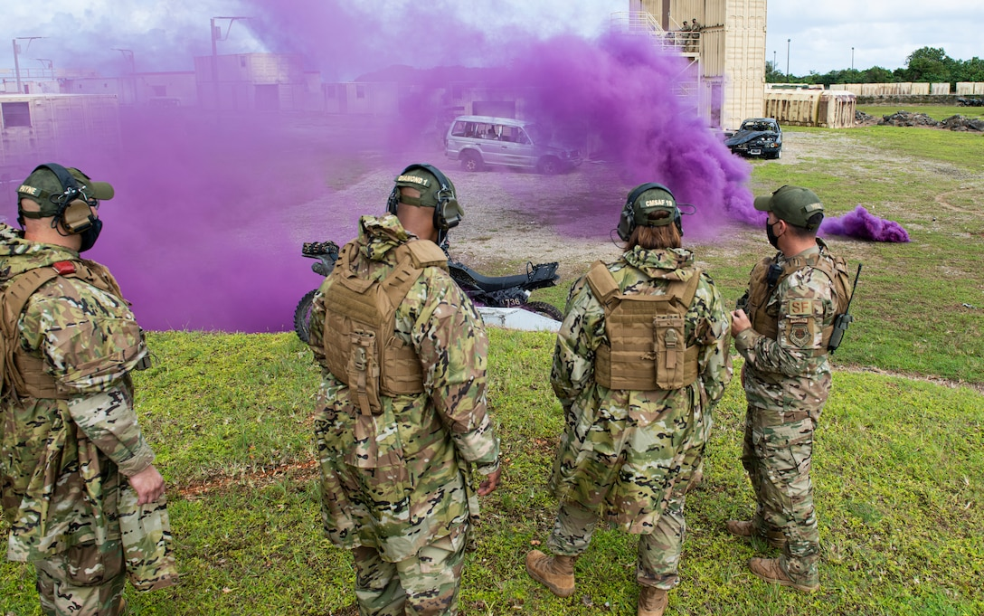 Chief Master Sergeant of the Air Force JoAnne S. Bass receives a brief from Commando Warrior cadre at North West Field, Guam, Aug. 27, 2021.