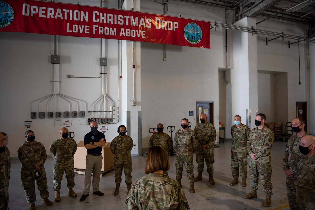 Chief Master Sergeant of the Air Force JoAnne S. Bass speaks with Airmen assigned to the 734th Air Mobility Squadron and the 44th Aerial Port Squadron about Operation Christmas Drop at Andersen Air Force Base, Guam, Aug. 27, 2021.
