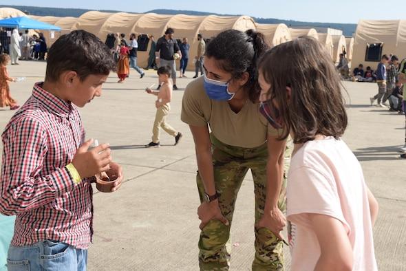 Volunteer interacts with children.