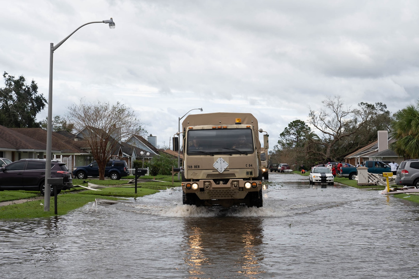 Louisiana National Guard members in high-water vehicles and boats work with St. John the Baptist Parish officials to rescue people stranded in their homes in the wake of Hurricane Ida.