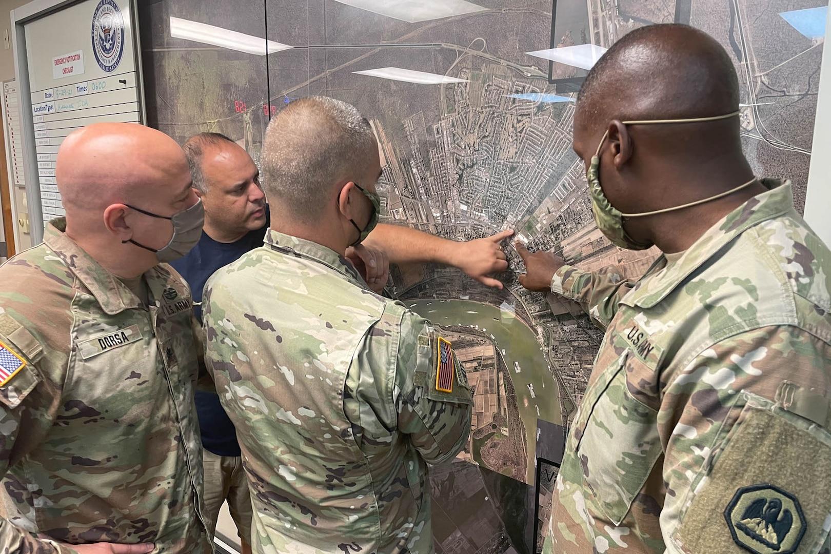 Members of the Louisiana National Guard coordinate Hurricane Ida response.