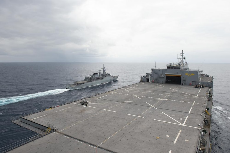 """Brazilian Navy frigate Independencia executes a manuever on the port side of the Expeditionary Sea Base USS Hershel """"Woody"""" Williams during manuevering drills, Aug. 22, 2021. Hershel """"Woody"""" Williams is on a scheduled deployment in the U.S. Sixth Fleet area of operations in support of U.S. national interests and security in Europe and Africa."""