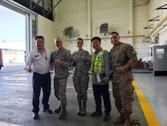 U.S. Air Force Staff Sgt. Angela Martinez, the 354th Civil Engineering Squadron (CES) noncommissioned in charge of material control, members from the Korean Airline and Airmen assigned to the 354th CES pose for a group photo on Gimhae Air Base, South Korea, April 2019.
