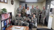 U.S. Air Force Staff Sgt. Angela Martinez, the 354th Civil Engineering Squadron (CES) noncommissioned in charge of material control, members from the Korean Airline fire department and Airmen assigned to the 354th CES pose for a group photo on Gimhae Air Base, South Korea, April 2019.