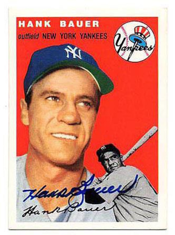 A photo on a baseball card shows a baseball player holding a bat.