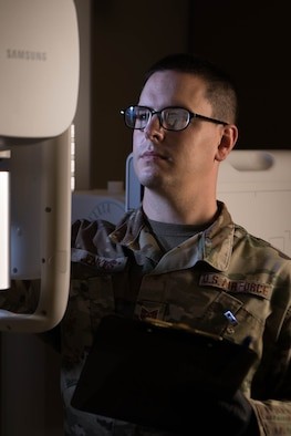 Tech. Sgt. Timothy Jenkins, 436th Medical Support Squadron Diagnostic Imaging section chief, verifies patient information on an X-ray machine on Dover Air Force Base, Delaware, Aug. 13, 2021. The six-person section handles all X-ray needs of beneficiaries at the 436th Medical Group. (U.S. Air Force photo by Mauricio Campino)