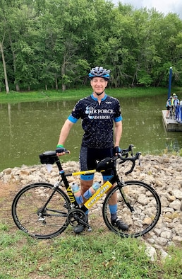 Brig. Gen. Jason Lindsey, Program Executive Officer for Presidential and Executive Airlift, during RAGBRAI, an annual, week-long bicycle ride across the State of Iowa.  RAGBRAI tradition is that you begin the ride by dipping your rear tire in the Missouri River or Big Sioux River - western border of Iowa - and end the ride by dipping your front tire in the Mississippi River on eastern border of Iowa. (Courtesy photo)