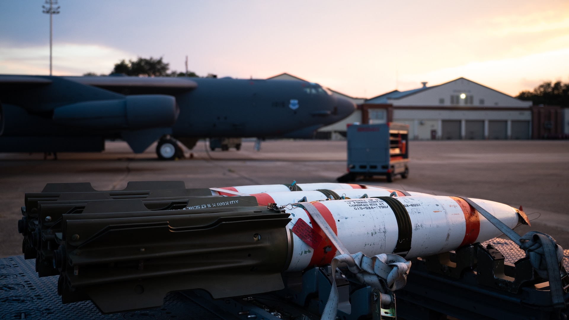 MK-62 Quickstrike naval mines sit in front of a B-52H Stratofortress at Barksdale Air Force Base, Louisiana, Aug. 25, 2021. The B-52 has the ability to carry and employ naval mines, as well as conventional and nuclear weapons. (U.S. Air Force photo by Senior Airman Jacob B. Wrightsman)