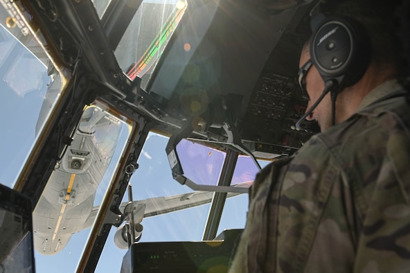 U.S. Air Force Lt. Col. Phillip Varilek, 71st Rescue Squadron HC-130J Combat King II pilot, positions an HC-130J below a KC-46A Pegasus assigned to the 916th Air Refueling Wing, Seymour Johnson Air Force Base, North Carolina, during an air-to-air refuel near Moody Air Force Base, Georgia, Aug. 24, 2021. The 71st RQS is the first operational unit to be refueled by the KC-46A Pegasus. (U.S. Air Force photo by Senior Airman Rebeckah Medeiros)