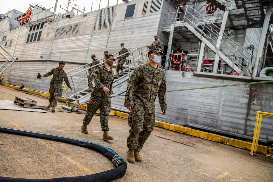 U.S. Marines with Special Purpose Marine Air-Ground Task Force - Southern Command debark from the Spearhead-class USNS Burlington (T-EPF 10) at Joint Expeditionary Base Little Creek-Fort Story, Virginia, Dec. 28, 2020.