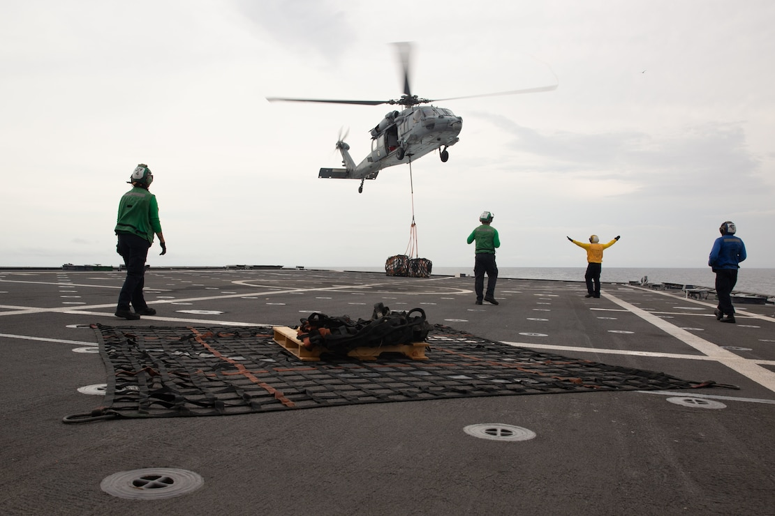 EASTERN PACIFIC OCEAN – Sailors aboard the Independence-class littoral combat ship USS Gabrielle Giffords (LCS 10) conduct a vertical replenishment Nov. 25, 2020