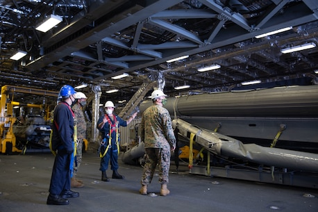 U.S. Marines with U.S. Marine Corps Forces, South assist with preparing to launch a rigid-hulled inflatable boat aboard the Independence-class littoral combat ship USS Gabrielle Giffords (LCS 10) Nov. 27, 2020.