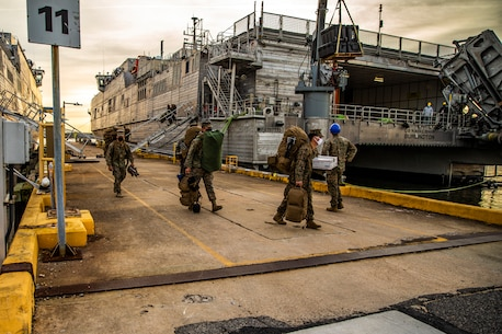 U.S. Marines with Special Purpose Marine Air-Ground Task Force - Southern Command unload gear from the Spearhead-class USNS Burlington (T-EPF 10) at Joint Expeditionary Base Little Creek-Fort Story, Virginia, Dec. 28, 2020