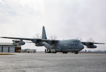 U.S. Marines conduct training unloading M142 High Mobility Artillery Rocket Systems from a Lockheed C-130 Hercules on Marine Corps Air Station New River, North Carolina, Jan. 26, 2020. MCAS New River provided training for Marines to unload M142 HIMARS. (U.S. Marine Corps photo by Cpl. Ginnie Lee)