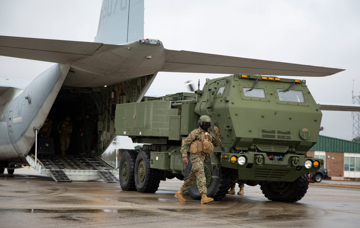 U.S. Marines conduct checks on a M142 High Mobility Artillery Rocket System after being unloading from a Lockheed C-130 Hercules during  training on Marine Corps Air Station New River, North Carolina, Jan. 26, 2020. MCAS New River provided training that included unloading M142 HIMARS from a Lockheed C-130. (U.S. Marine Corps photo by Cpl. Ginnie Lee)