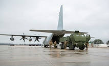 U.S. Marines conduct checks on a M142 High Mobility Artillery Rocket System after being unloaded from a Lockhead C-130 Hercules during training on Marine Corps Air Station New River, North Carolina, Jan. 26, 2020. MCAS New River provided training that included unloading M142 HIMARS from a Lockheed C-130 Hercules. (U.S. Marine Corps photo by Cpl. Ginnie Lee)