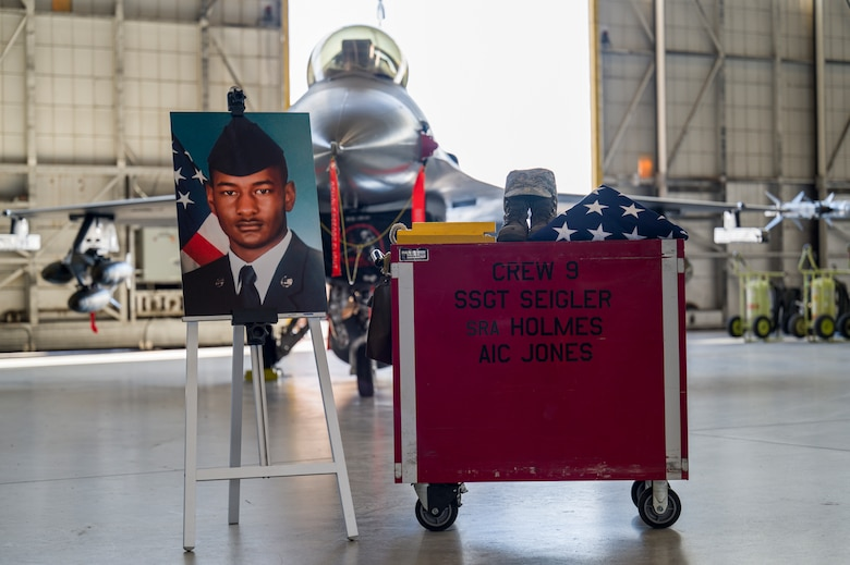 Airmen from 412th Maintenance Squadron held a memorial ceremony for Senior Airman Robert Holmes, Jr., at Edwards Air Force Base, California, Jan. 29. Holmes was assigned to the 416th Aircraft Maintenance Unit Weapons Section, where he worked as a weapons load crew team member on a fleet of 25 F-16 Fighting Falcons. Holmes was  awarded Air Force Achievement Medal posthumously. (Air Force photo by Giancarlo Casem)