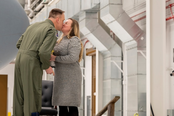 Lt. Col. Bryan Bailey, 911th Operations Group commander, kisses his wife Aaron Bailey during an assumption of command for the 911th OG at the Pittsburgh International Airport Air Reserve Station, Pennsylvania, Jan. 10, 2021.