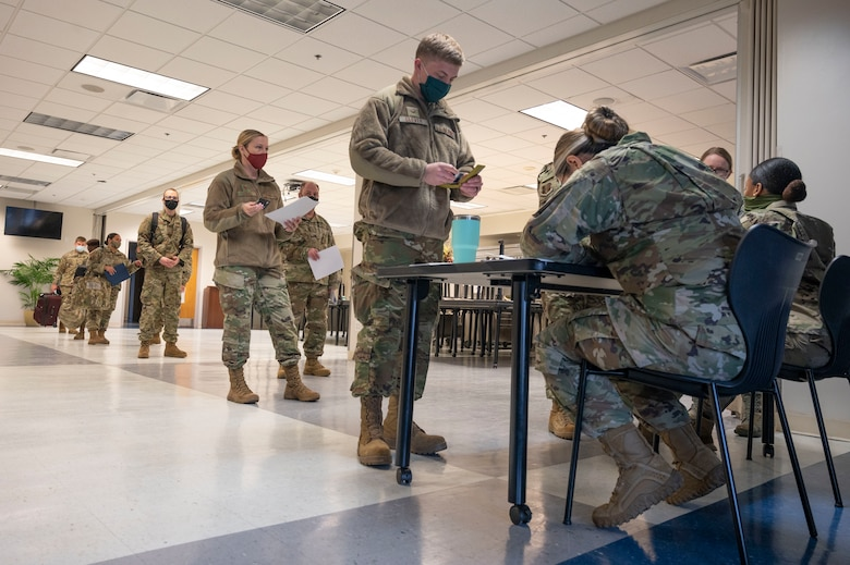 About half of the 60 Florida National Guard Airmen activated to support the COVID-19 vaccination mission at Regency Mall outprocess at the 125th Fighter Wing in Jacksonville, Florida, Feb. 1, 2021.