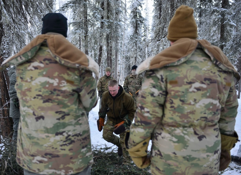 U.S. Air Force Staff Sgt. Samuel Ley, a Survival, Evasion, Resistance and Escape specialist assigned to the Arctic Survival Training School, demonstrates how to set up a thermalized A-frame survival shelter on Eielson Air Force Base, Alaska, Jan. 27, 2021.