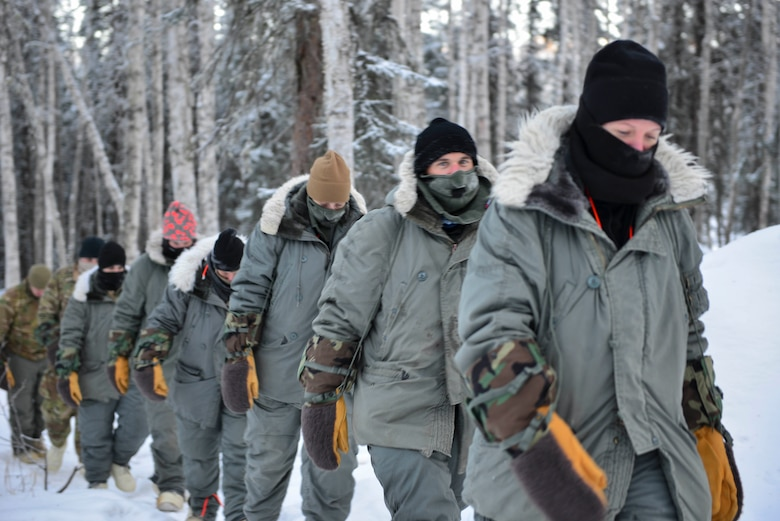 Arctic Survival Training students rally back to their shelters on Eielson Air Force Base, Alaska, Jan. 27, 2021.