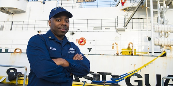 Chief Petty Officer Spencer Wilson pauses for a photo by Coast Guard Cutter Alex Haley in Kodiak, Alaska, Feb. 13, 2015. Wilson, a damage controlman aboard the cutter, is a passionate believer in celebrating the positive influences and traditions that African Americans enrich our nation with. (U.S. Coast Guard photo by Petty Officer 2nd Class Diana Honings)