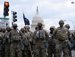 U.S. Soldiers with the Indiana National Guard National Guard stand in formation, in Washington, D.C., Jan. 20, 2021. At least 25,000 National Guard men and women have been authorized to conduct security, communication and logistical missions in support of federal and District authorities leading up and through the 59th Presidential Inauguration. (U.S. Army National Guard photo by Sgt. Tackora Hand)