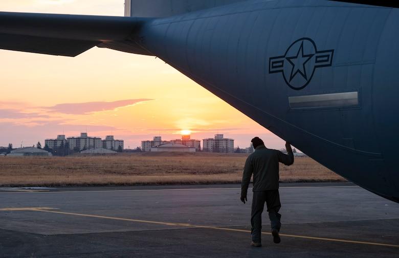 Tech. Sgt. Brian Gates, 36th Airlift Squadron loadmaster, performs pre-flight checks on a C-130J Super Hercules, at Yokota Air Base, Japan, Jan. 22, 2021.