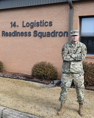 U.S. Air Force Lt. Col. Michael Kennedy, 14th Logistics Readiness Squadron commander, stands in front of the 14th LRS building on Jan. 27, 2021, at Columbus Air Force Base, Miss. The 14th LRS provides effective logistics support for the 14th Flying Training Wing's flying training mission. (U.S. Air Force photo by Airman 1st Class Davis Donaldson)