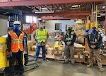 Some of the team members at the Defense Logistics Agency Disposition Services site at Camp Pendleton, California. David Monroe by the forklift, Area Manager Luis Guzman, Enmanuel Veciana, Supervisor Jason Cummings. Photo by John Taylor.