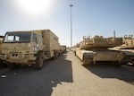 Humvees, M2 Bradley Fighting Vehicles and other vehicles are staged for transfer at the Port of Shuaiba for the upcoming Iron Union exercise Jan. 21, 2020 at the Port of Shuaiba, Kuwait. The equipment and rolling stock will go through the same process in the United Arab Emirates once the Iron Union 14 exercise has concluded. The 1185th DDSB will coordinate with adjacent units in the UAE to receive the stock back at the Port of Shuaiba. (U.S. Army photo by Spc. Zoran Raduka, 1st TSC Public Affairs)