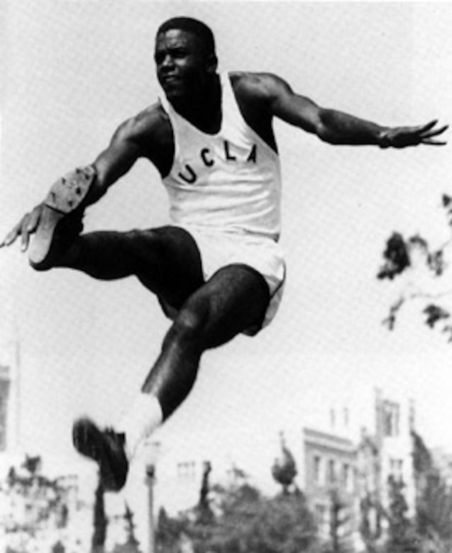 An athlete jumps high into the air.
