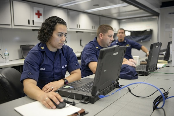 Petty Officer 2nd Class Kelly Badal, a crew member of Coast Guard Communication Command, works on a computer inside a Coast Guard enhanced mobile incident command post (EMICP) in Bayonne, N.J., Wednesday, Sept. 23, 2015. The EMICP provided a spacious and climate-controlled environment, voice and data connectivity as well as acted as the security command post during the papal visit and United Nations General Assembly in New York. (Coast Guard photo by Petty Officer 3rd Class Frank Iannazzo-Simmons)