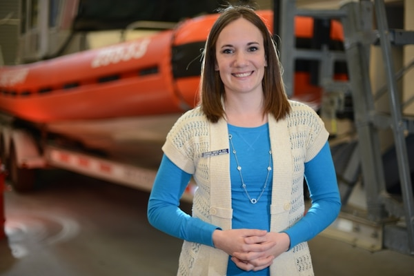 Dana Moehling, the ombudsman for Coast Guard Station Cape May, N.J., poses in front of a response boat at the station Thursday, Feb. 19, 2015. The Coast Guard Ombudsman Program aims to enhance communication between the command and Coast Guard family members. (U.S. Coast Guard photo by Petty Officer 1st Class Nick Ameen)