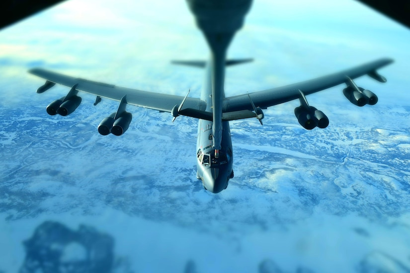 An airplane is refueled in midair.