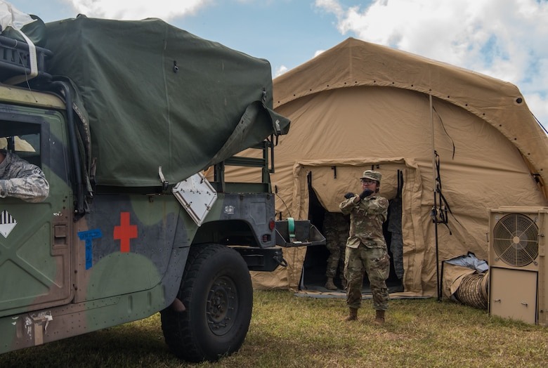 U.S. Air Force Staff Sgt. Christine Ebio assigned to the 18th Medical Group, Kadena Air Base, Japan, directs a Humvee for a patient transport during a Cope North 20 (CN20) mass casualty exercise at Rota, U.S. Commonwealth of the Northern Mariana Islands, Feb 20, 2020. Service members from the U.S., Royal Australian Air force, and Koku Jieitai (Japan Air Self-Defense Force) honed their Humanitarian Assistance and Disaster Relief (HADR) skills by providing emergency medical care for simulated patients. Cope North enhances U.S. relations with regional allies and partners by demonstrating resolve to promote security and stability throughout the Indo-Pacific. (U.S. Air Force photo by Staff Sgt. Curt Beach)