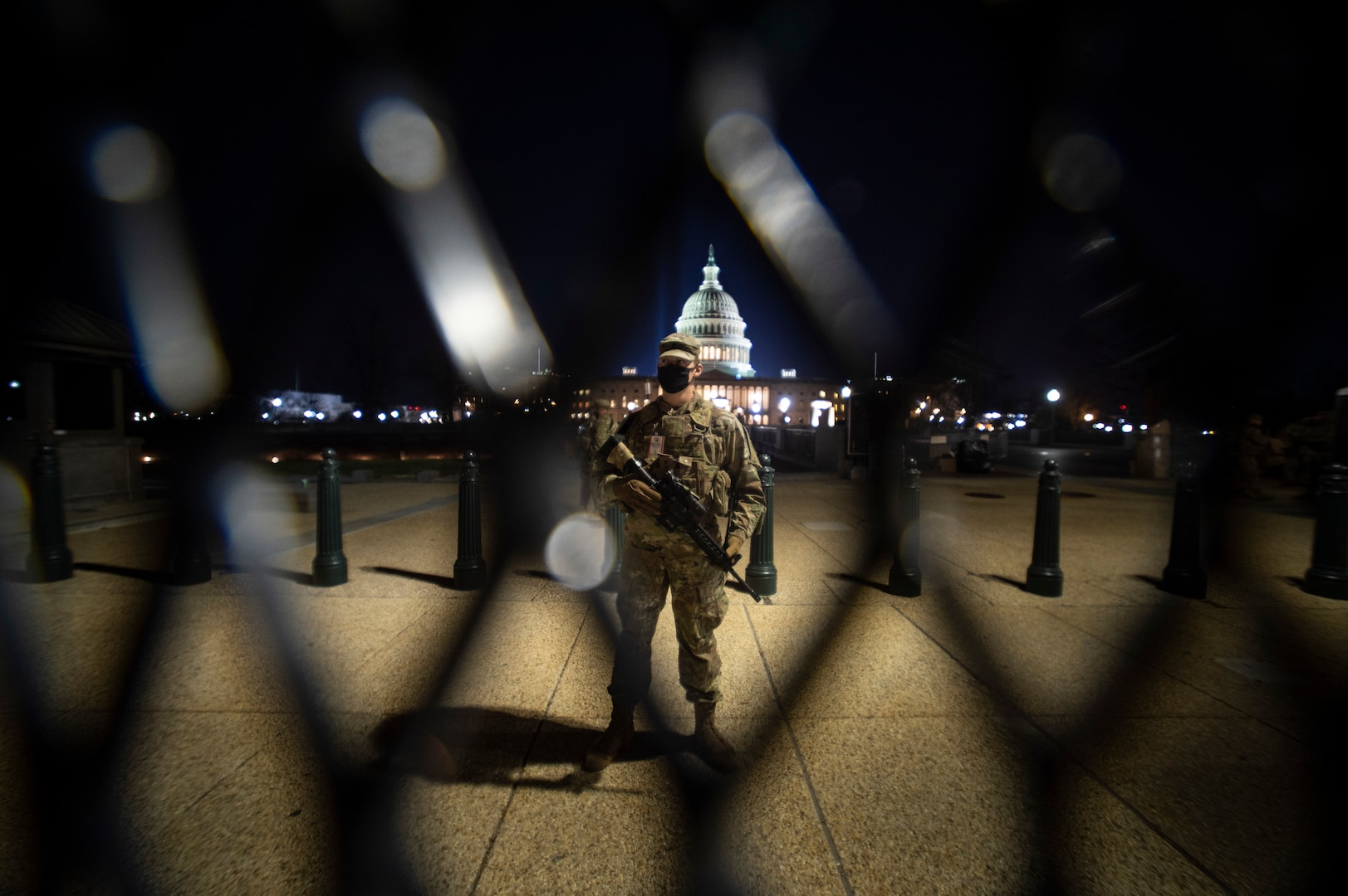 An Oklahoma Army National Guard Soldier stands watch at the U.S. Capitol building, Jan. 19, 2021. At least 25,000 National Guard men and women have been authorized to conduct security, communication and logistical missions in support of federal and District authorities leading up to and through the 59th Presidential Inauguration. (U.S. National Guard photo by Sgt. Anthony Jones)