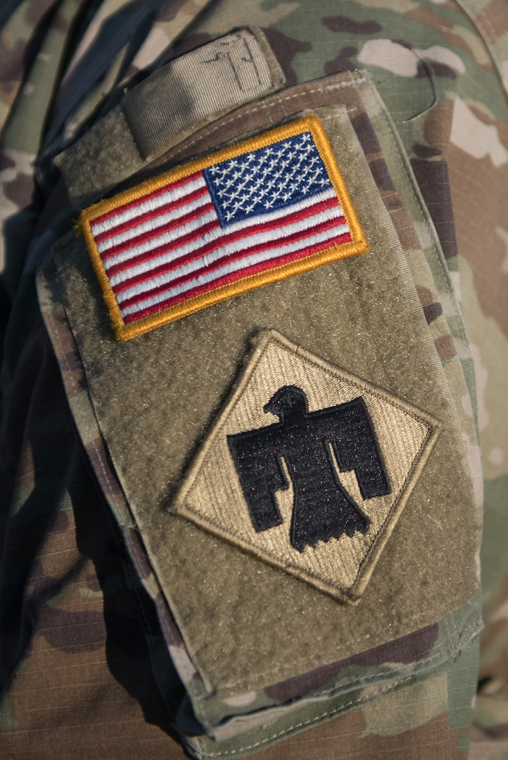 An American flag and thunderbird patch are displayed on the uniform of a U.S. Soldier with the Oklahoma National Guard while providing security near the U.S. Capitol building, Washington, D.C., Jan. 20, 2021. At least 25,000 National Guard men and women have been authorized to conduct security, communication and logistical missions in support of federal and District authorities leading up and through the 59th Presidential Inauguration. (U.S. Air National Guard photo by Tech. Sgt. Rebecca Imwalle)