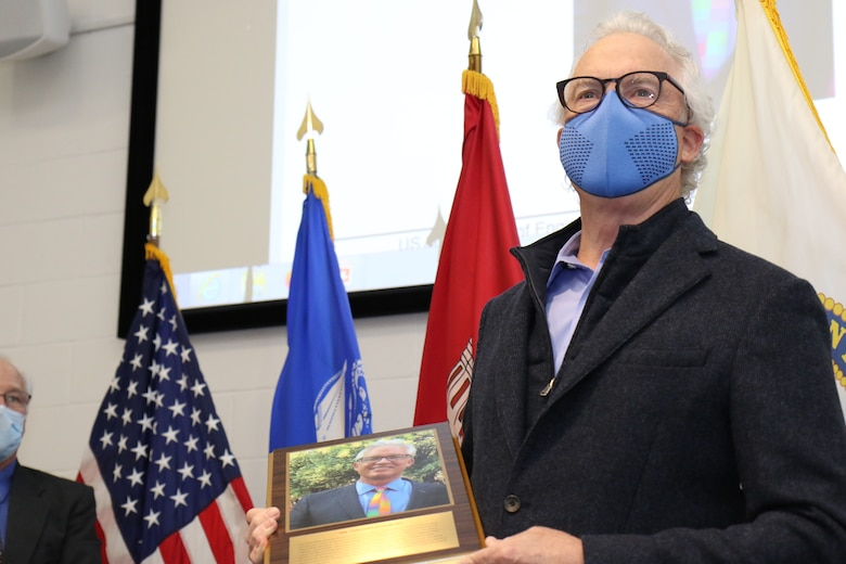 031220-A-LI860-035 Tim Pangburn receives the 2020 Distinguished Employee Award during a ceremony at the Cold Regions Research and Engineering Laboratory (CRREL) in Hanover, N.H., Dec. 3, 2020. CRREL Director Dr. Joseph Corriveau presented Pangburn with the award to recognize his lifelong commitment to civil service between 1978 until his retirement in 2017.  Pangburn's portrait will be immortalized in the CRREL Gallery of Distinguished Employees, which was established in 1986 as part of the laboratory's Silver Jubilee Year. The first Distinguished Employee recognized in the gallery is W. Keith Boyd, the first CRREL technical director. Boyd facilitated the 1961 establishment of CRREL in Hanover, and his leadership enhanced CRREL's stature and reputation as a leader in cold regions research throughout the world. (U.S. Army Photo by David Marquis)