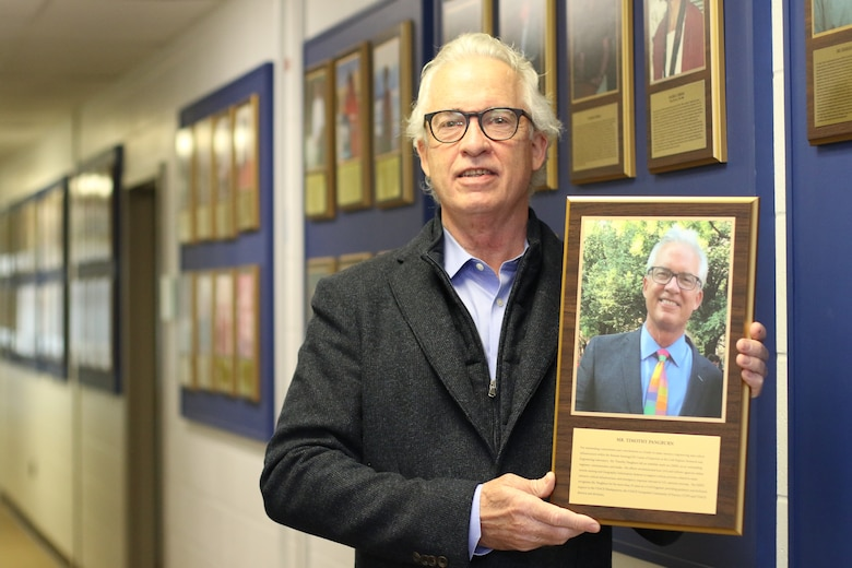 Tim Pangburn adds his portrait to the Cold Regions Research and Engineering Laboratory (CRREL) Gallery of Distinguished Employees in Hanover, N.H., Dec. 3, 2002. Panburn started working for CRREL in 1978 as a civil engineering technician, until his retirement in 2017 as a director for the U.S. Army Corps of Engineers Remote Sensing/Geographic Information Systems Center of Expertise.  The CRREL Gallery of Distinguished Employees was established in 1986 as part of the laboratory's Silver Jubilee Year. The first distinguished employee recognized in the gallery is W. Keith Boyd, the first CRREL technical director. Boyd facilitated the 1961 establishment of CRREL in Hanover, and his leadership enhanced CRREL's stature and reputation as a leader in cold regions research throughout the world. (U.S. Army Photo by David Marquis)
