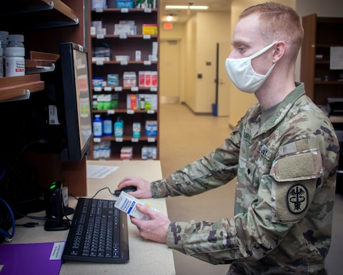 Army Spc. Trevor Osburn, pharmacy technician, fills prescriptions at the Community Pharmacy in the Exchange at Joint Base San Antonio-Fort Sam Houston Feb. 1. The Community Pharmacy fills an average of 330 new prescriptions and 1,440 refills daily.