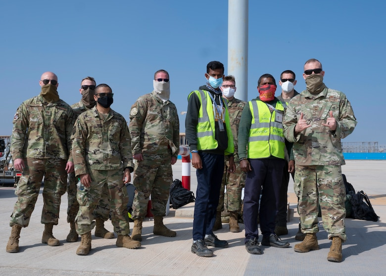 Airmen assigned to the 34th Expeditionary Bomb Squadron, Ellsworth Air Force Base, S.D., pose alongside Indian airfield operations specialists at Kempegowda International Airport in Bengaluru, India, Feb. 1, 2021. The 34th EBS is in India to support the B-1's participation in Aero India 2021. Aero India provides the opportunity to build a stronger relationship between the United States and India, as well as with the international community. (U.S. Air Force photo by Senior Airman Christina Bennett)