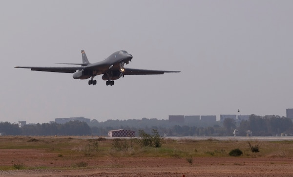 A B-1B Lancer assigned to the 34th Expeditionary Bomb Squadron, Ellsworth Air Force Base, S.D., prepares to land at Kempegowda International Airport in Bengaluru, India, Feb. 1, 2021. Aero India is an ideal forum to showcase U.S. defense aircraft and equipment and ultimately contribute toward compatibility and interoperability with other countries. (U.S. Air Force photo by Senior Airman Christina Bennett)