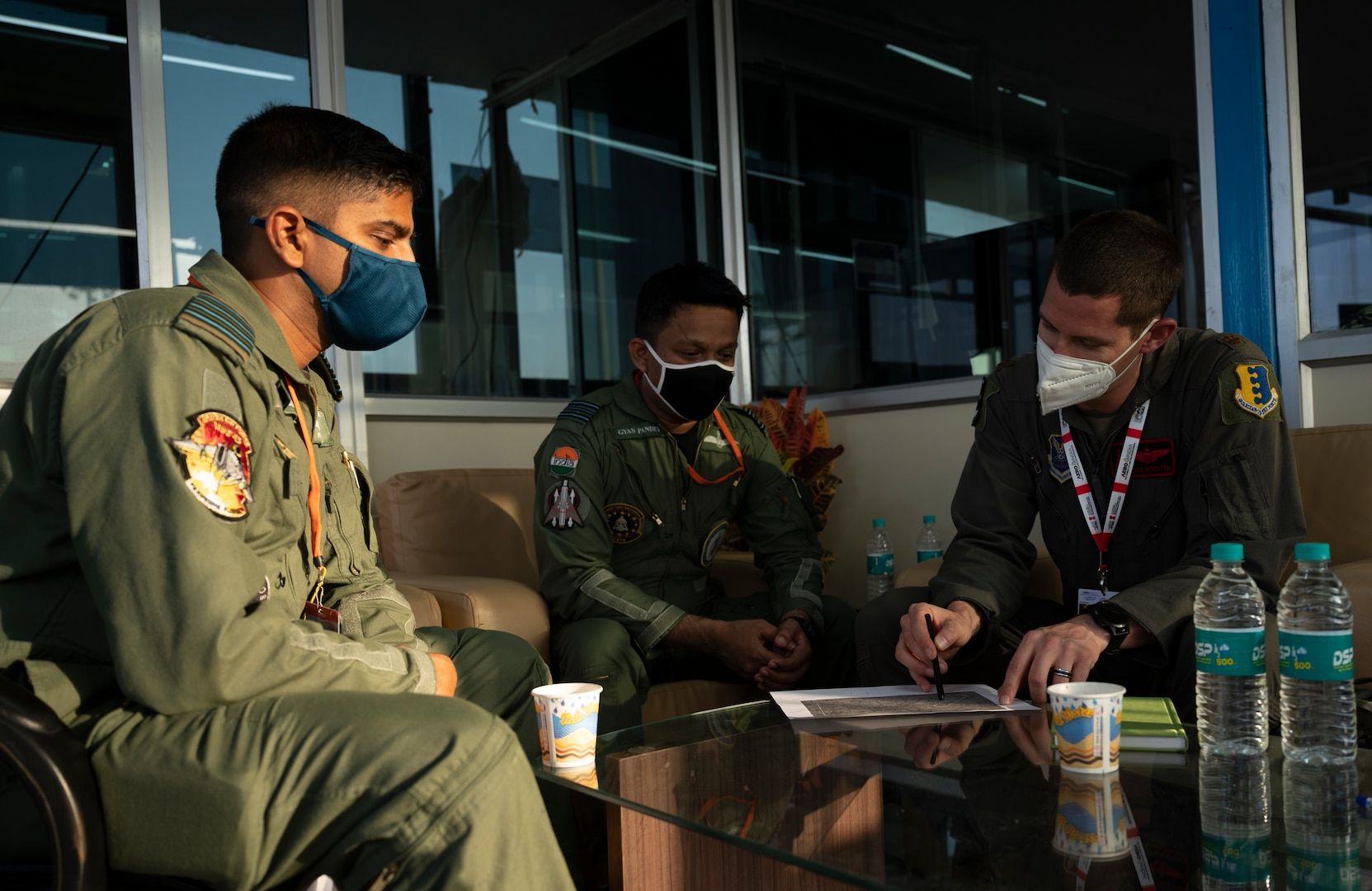 Maj. Andrew Moenter, a 34th Expeditionary Bomb Squadron pilot, meets with Indian Air Force pilots in preparation of the B-1B Lancer's participation in Aero India 2021, at Yelahanka Air Force Base in Bengaluru, India, Feb. 1, 2021. Aero India is an ideal forum to showcase U.S. defense aircraft and equipment and ultimately contribute toward compatibility and interoperability with other countries. (U.S. Air Force photo by Senior Airman Christina Bennett)