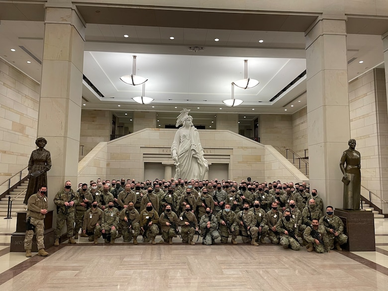Members from the 128th Air Refueling Wing along with the rest of Sijan Company pose for a group photo on the U.S. Capitol grounds Jan. 19, 2021. In the days leading up to the 59th presidential inauguration more than 125 Wisconsin Airmen from the 128th Air Refueling Wing, 115th Fighter Wing and Volk Field Combat Readiness Training Center mobilized to Washington D.C. to assist with security efforts for the event. (Courtesy Photo)