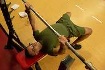 U.S. Marine Corps Sgt. Ezequiel Velazquez, an Intelligence Analyst with U.S. Marine Corps Forces Command, Fleet Marine Force Atlantic, executes a bench press with the proper posture during a High Intensity Tactical Training (HITT) course in the Hopkins Gymnasium on Camp Elmore, Norfolk, Virginia, January 27, 2021. HITT is a comprehensive strength and conditioning program that focuses on maintaining and improving physical resiliency and combat readiness. The Marines that progressed through the course will be a knowledgeable resource for physical training (PT) and will be able to conduct PT properly within their respective units. (U.S. Marine Corps Photo by Lance Cpl. Jack Chen/released)