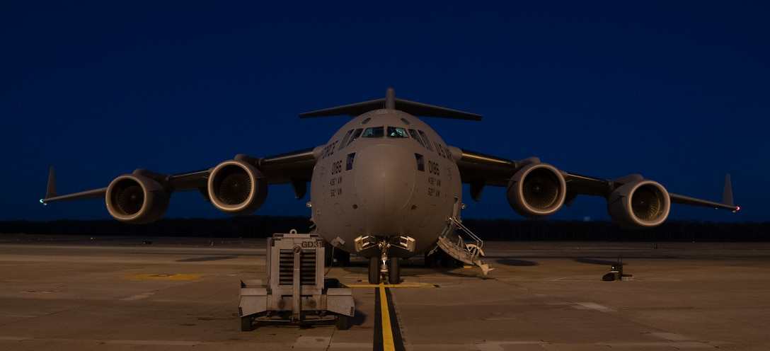 A C-17 Globemaster III is prepared for a night training mission at Dover Air Force Base, Delaware, Jan. 28, 2021. Dover AFB supports 20% of the nation's strategic airlift and routinely flies local training missions to sustain mission readiness for global operations. Night training missions serve to ensure aircrew effectiveness and readiness in contested and challenging environments. (U.S. Air Force photo by Airman 1st Class Faith Schaefer)